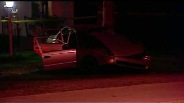 Image Car hits tree in KC