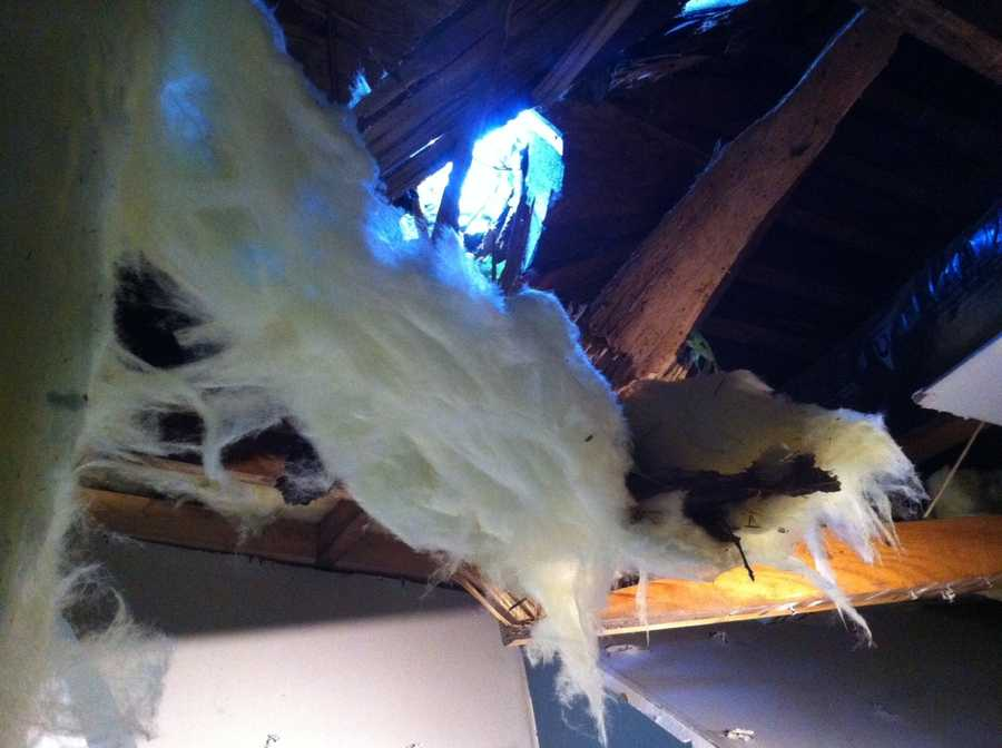 A tree limb punches through the roof of a home at 68th and Wornall.Upload your own pictures to u Local