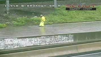 Work crews went out into the flooding lanes to look for clogged drainage areas.