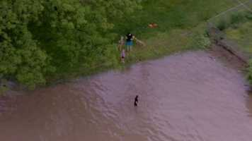 Kids playing in high water. Emergency officials ask that you NOT do this.