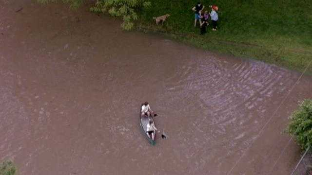 Kids in a canoe in high water, emergency officials are asking that you NOT do this.