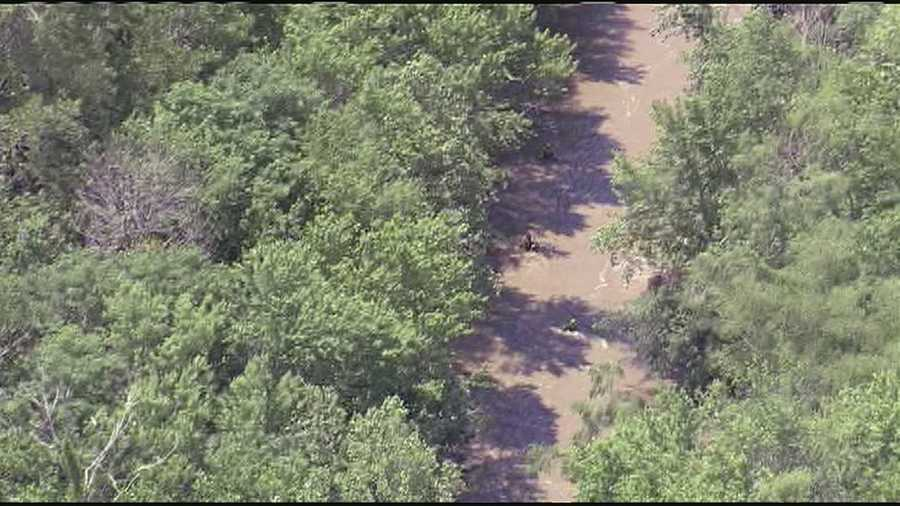 Members of the Missouri Highway Patrol searched a creek outside Harrisonville on Monday after a teen disappeared when the boat he was on capsized in the creek on Sunday.