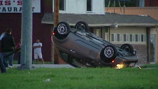 Car flips seconds before live report in KCK