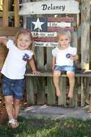"MARCELINE, Mo. - These little ones light up a smile in front of life, liberty and pursuit of happiness display.  A proud grandparent describes the photo as ""my two sweet granddaughters in shirts made by Mema inspired by pintrest and in dresses made by their Mommy."""
