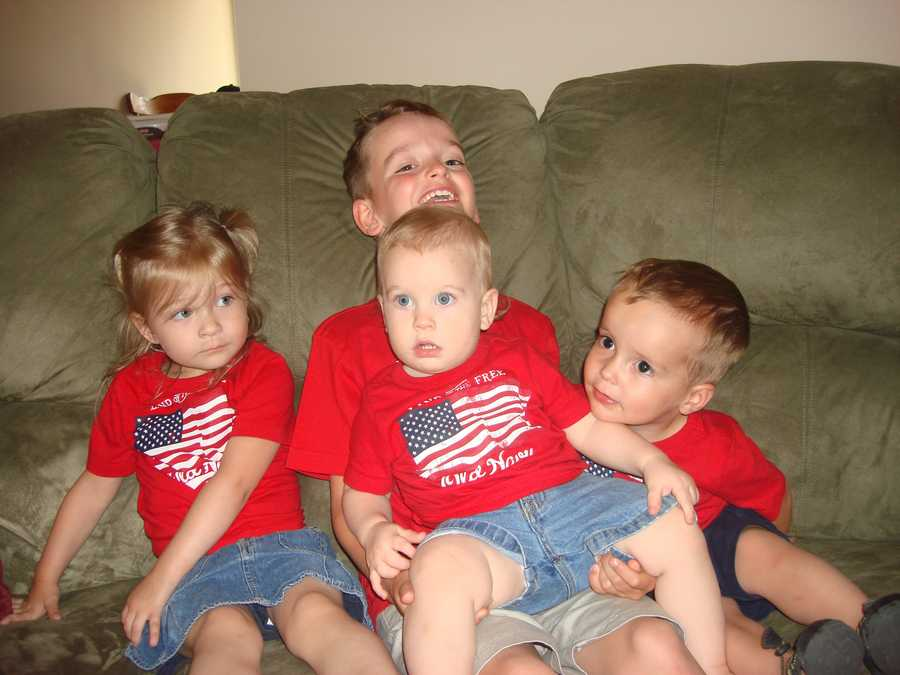 """GLADSTONE, Mo. - Grandma """"Nana"""" proudly shows off her 4th of July cuties: Sophie, Sky, Jesse and Kian."""