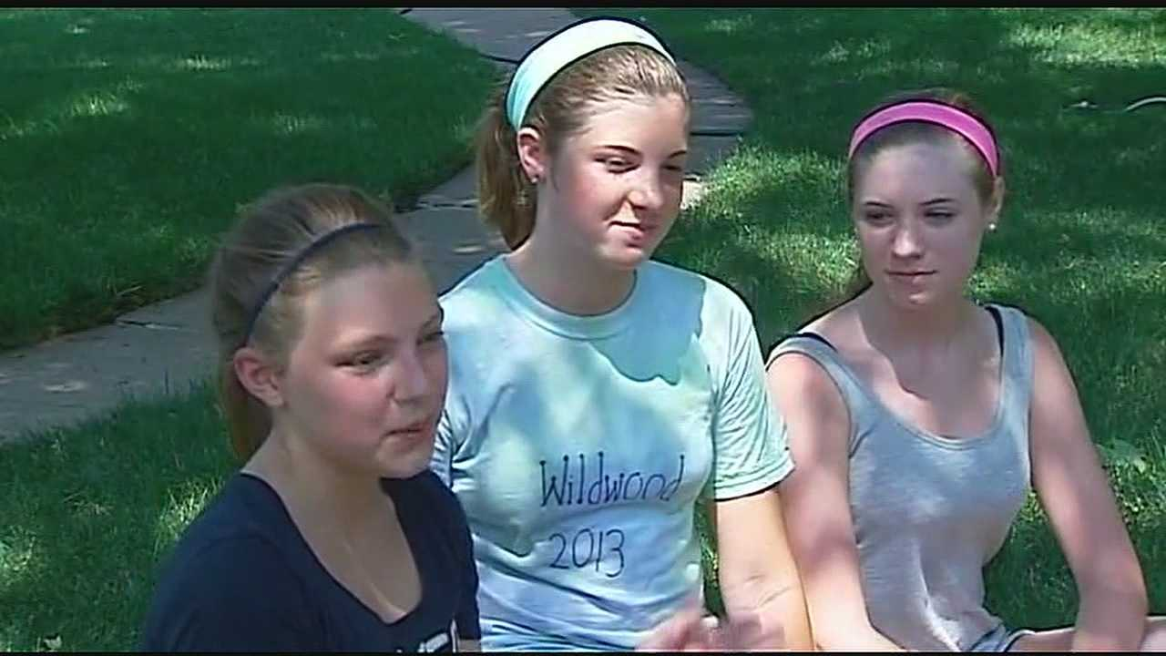 Three girls in Fairway used Tuesday's extreme heat to try to make some money with a lemonade stand.