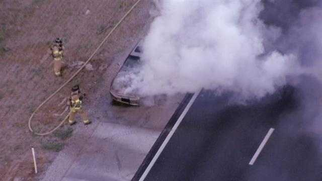 Car fire on I-35 at College Boulevard