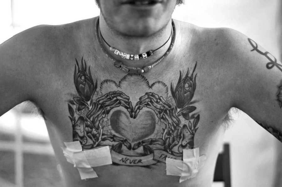 Rogers has an elaborate tattoo across his chest, along with tape that many runners use to prevent nipple chafing while covering long distances.
