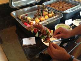 Skewers of with peppers and locally made Scimeca's sausage drizzled with a cilantro creme fraiche.