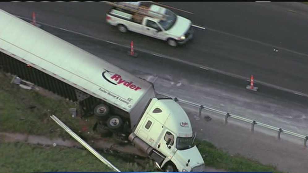 Overturned tractor-trailer WB I-70