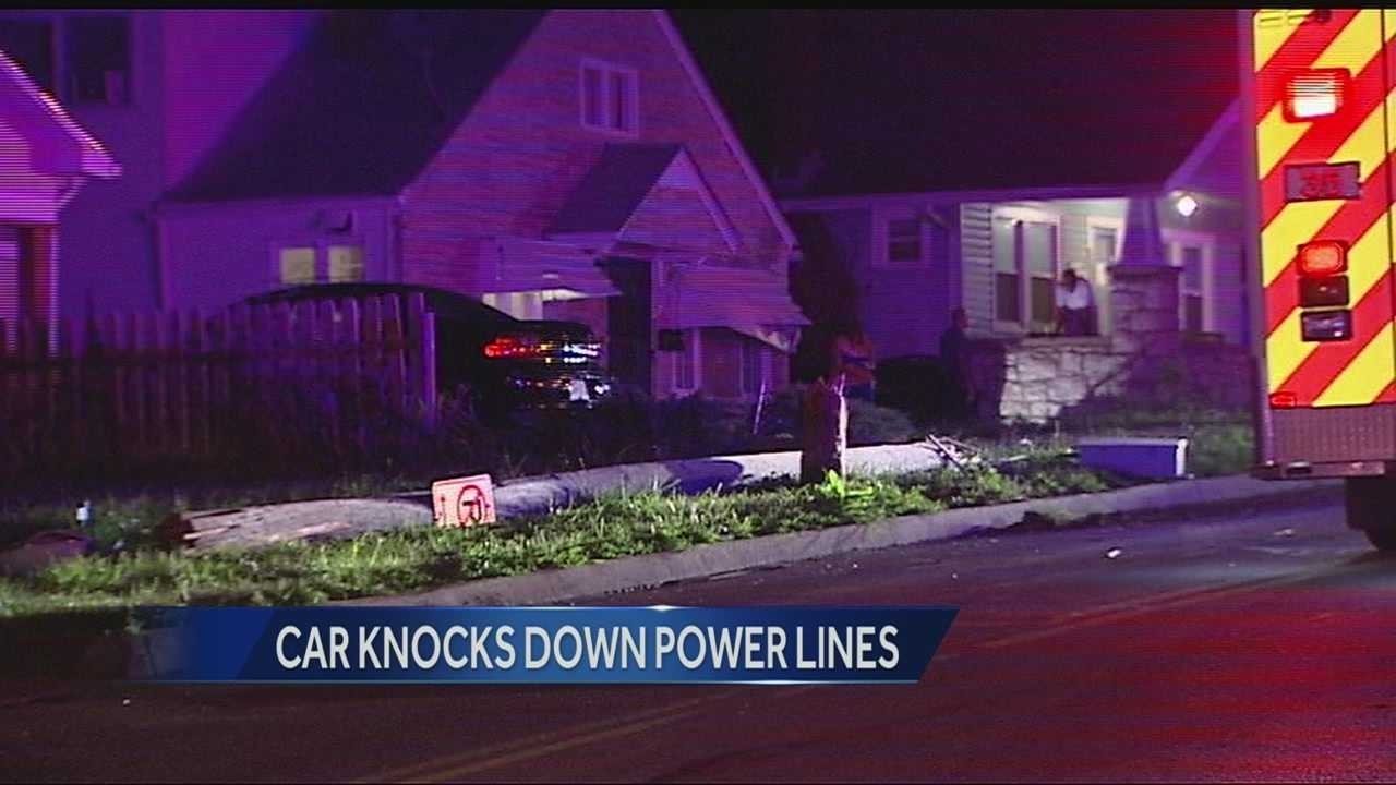 Car knocks down power pole, 38th, Cleveland