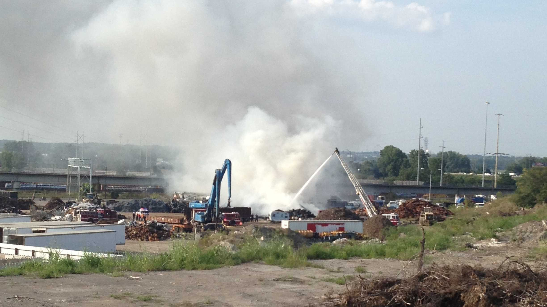 Tire fire burns at scrapyard off of I-435