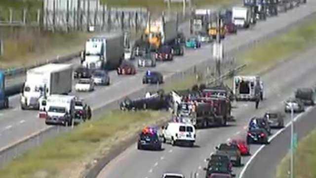 Vehicle rolls over on I-435, traffic backing up