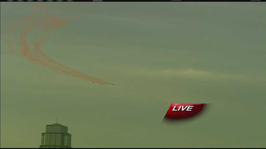 Images of planes that flew in formation over downtown Kansas City and spread red smoke to help celebrate the Kansas City Chiefs' home opener on Sunday and Red Friday.