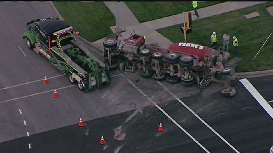 Cement truck overturns at 135th, Metcalf