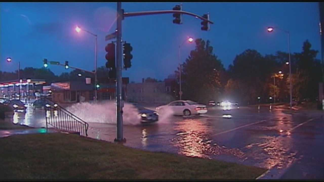 Street flooding across the Kansas City area, particularly in Westport, forced firefighters to help 20 people who had driven their cars into high water.