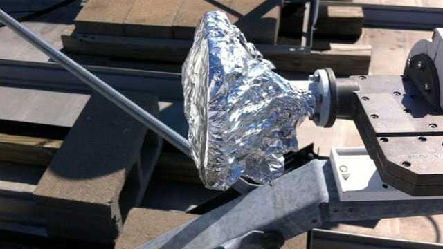 Image Foil on satellite dish scam