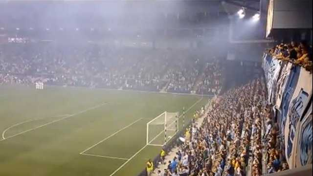 Crowd sings National Anthem at SKC game
