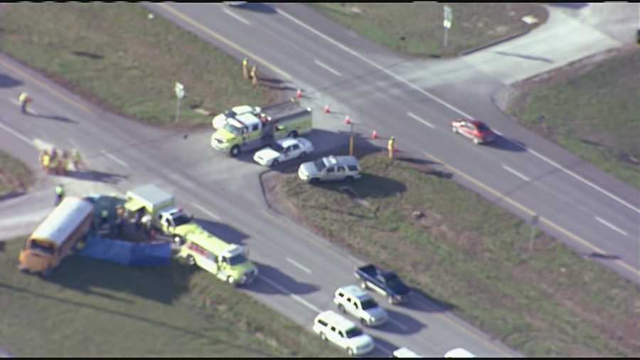 Images from a deadly collision between an SUV and school bus in Warrensburg, Mo. The two people killed in the crash were in the SUV.