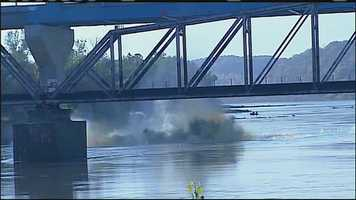 Images from the final explosion of the demolition of the old Amelia Earhart bridge in Atchison, Kan.