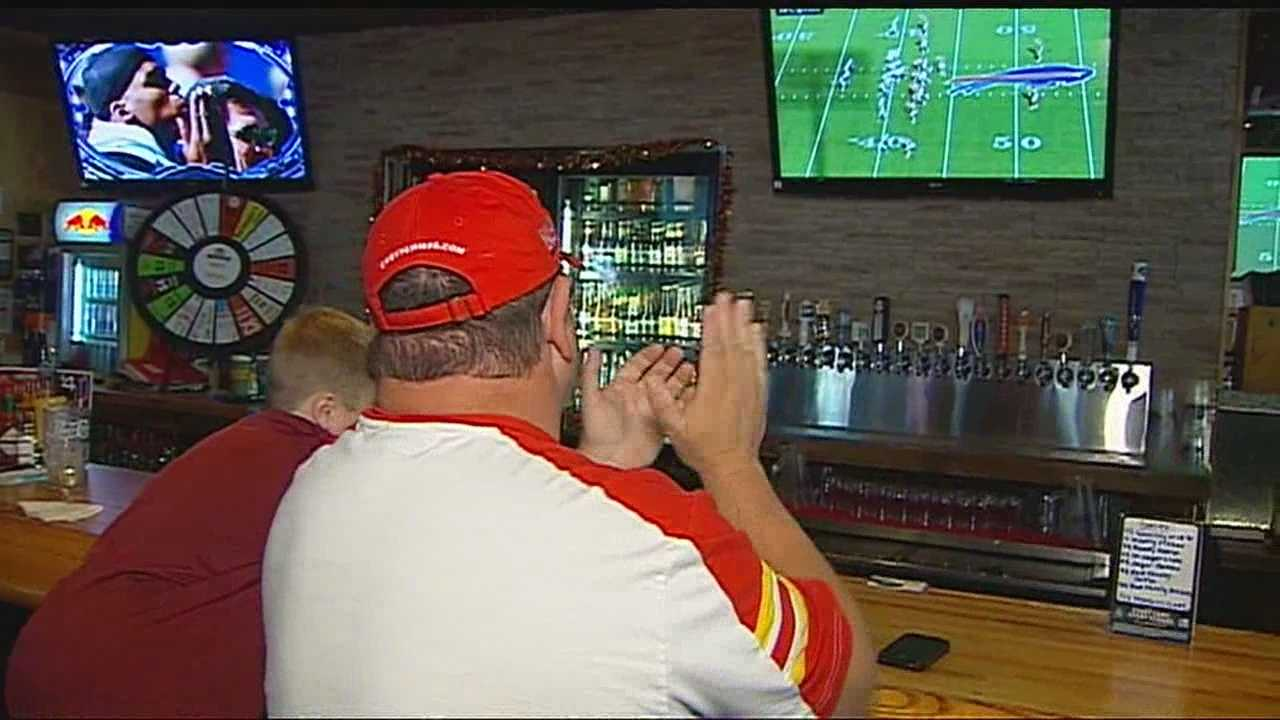 Image Chiefs fans watch game at bar