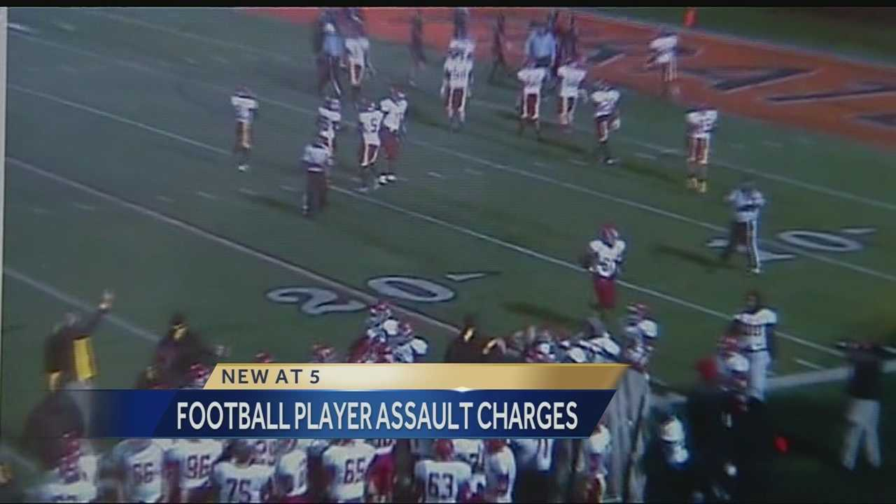 A Platte County High School football player is charged with assault after prosecutors said he tore another player's helmet off during a game and hit him in the head with it.