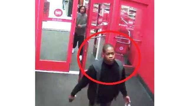 Investigators say two men robbed a woman at gunpoint in the parking lot on the north side of the mall.