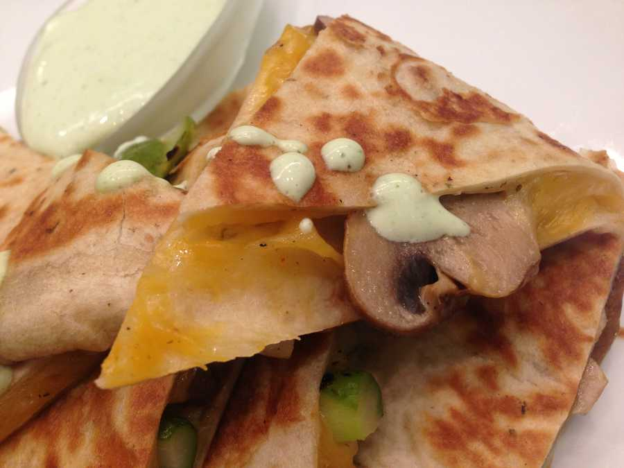 Signature Asparagus and Mushroom Quesadillas with a cilantro lime crème fraîche drizzled right there.