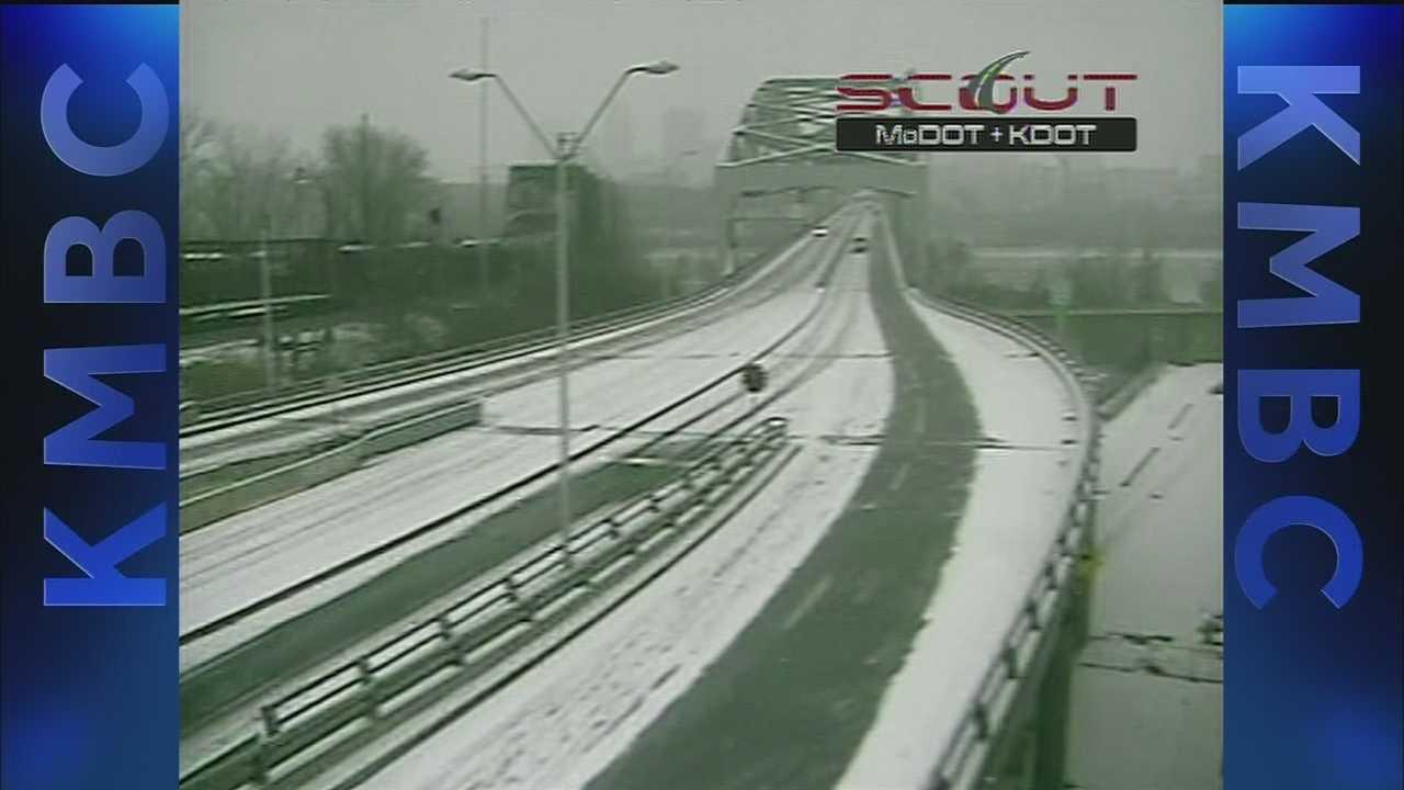 Image Snowy road leading to Broadway Bridge