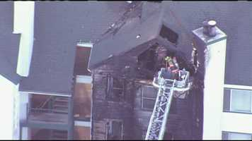 Images from an apartment fire at 39th Street and Redwood Drive in Independence, Mo., on Wednesday afternoon. It appeared the fire damaged at least three units and three floors.