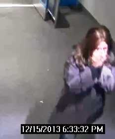 Investigators said the suspect covered her face with her hands in an effort to avoid surveillance cameras as she walked in and left the business.