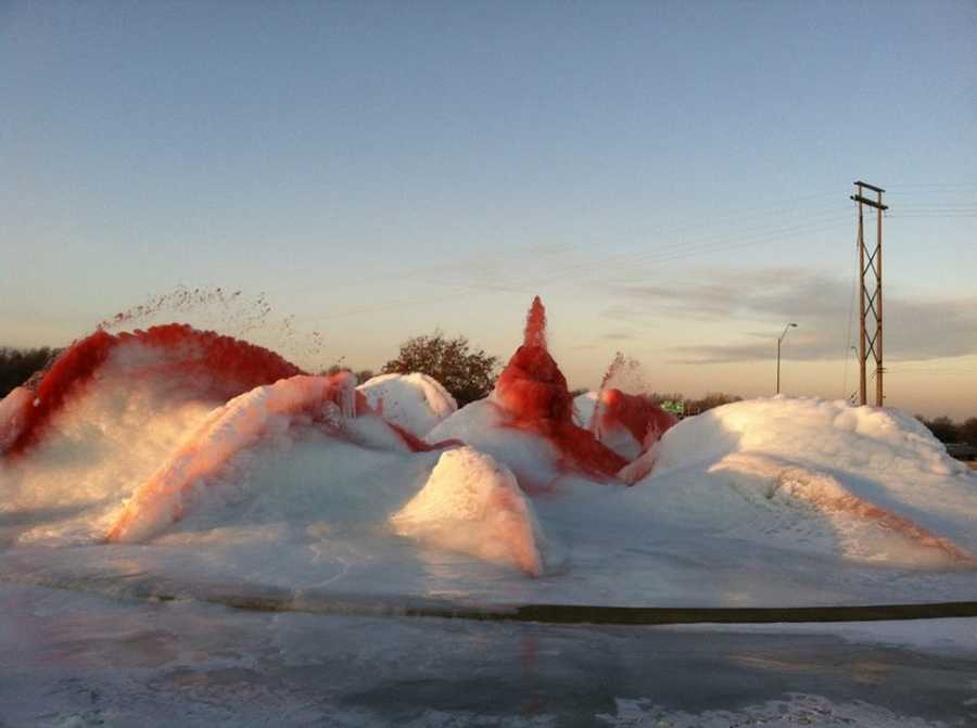 The Northland fountain at NE Vivion and North Oak Trafficway was dyed red on Friday in support of the Kansas City Chiefs.  These are images of the frozen fountain.