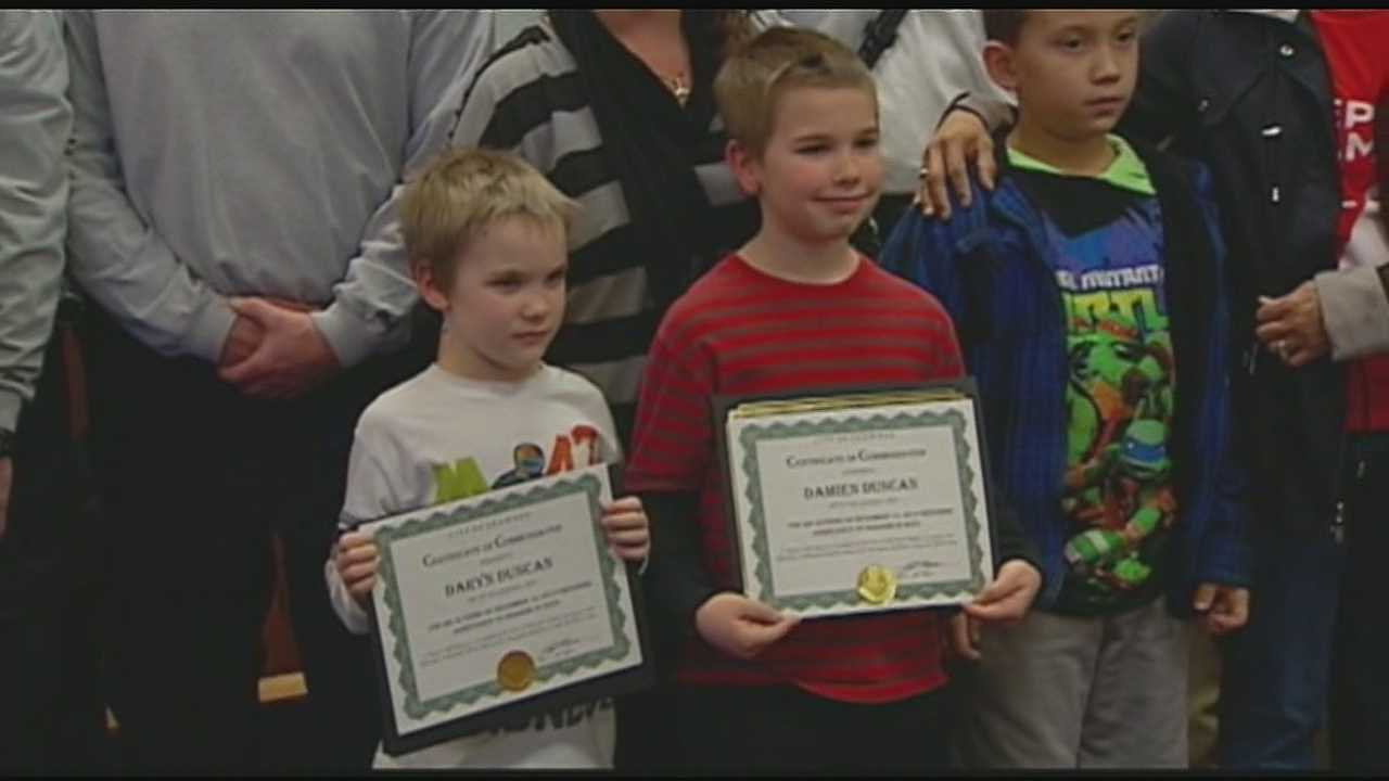Shawnee honors 2 boys for saving family from fire img