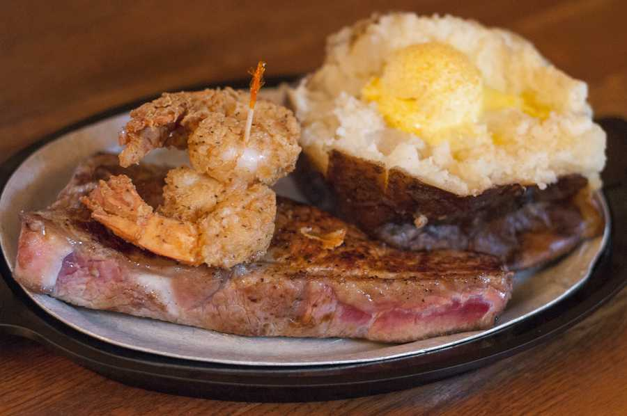 Steak, a baked potato and two shrimp provide a classic taste at Jess & Jim's Steakhouse.