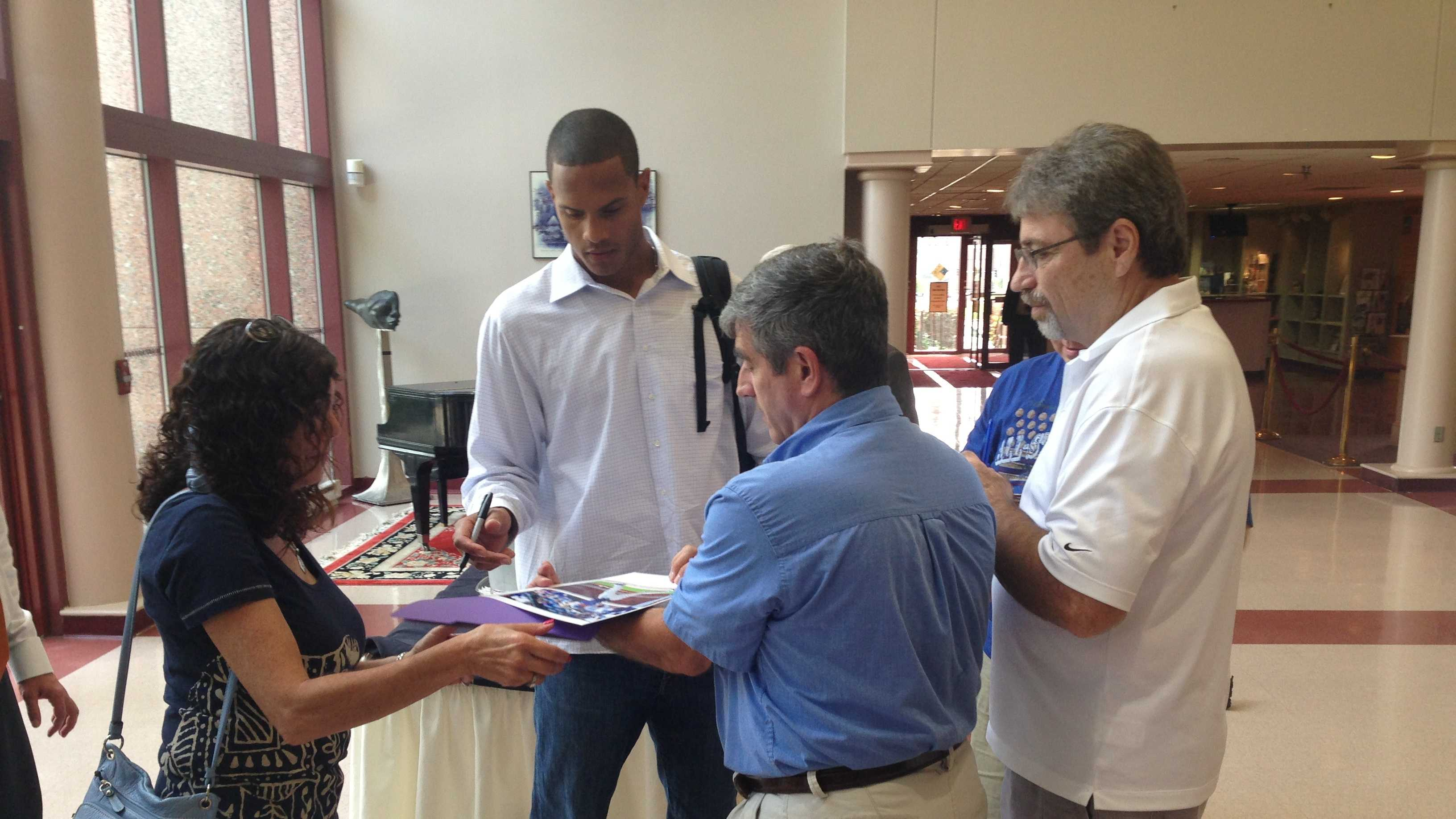 Maxwell signs autographs while participating in a luncheon hosted by the Negro Leagues Baseball Museum at the Bruce R. Watkins Cultural Heritage Center.  August 2013.