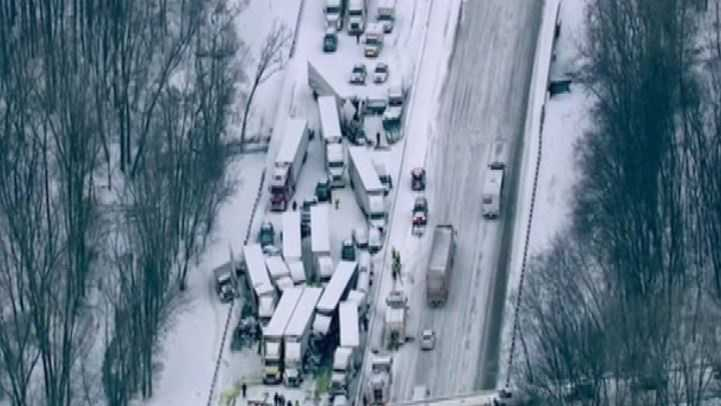 About 30 vehicles, half of the semitrailers, collided amid whiteout conditions in a massive highway pileup that left three people dead and more than 20 others injured in northwestern Indiana, police said.