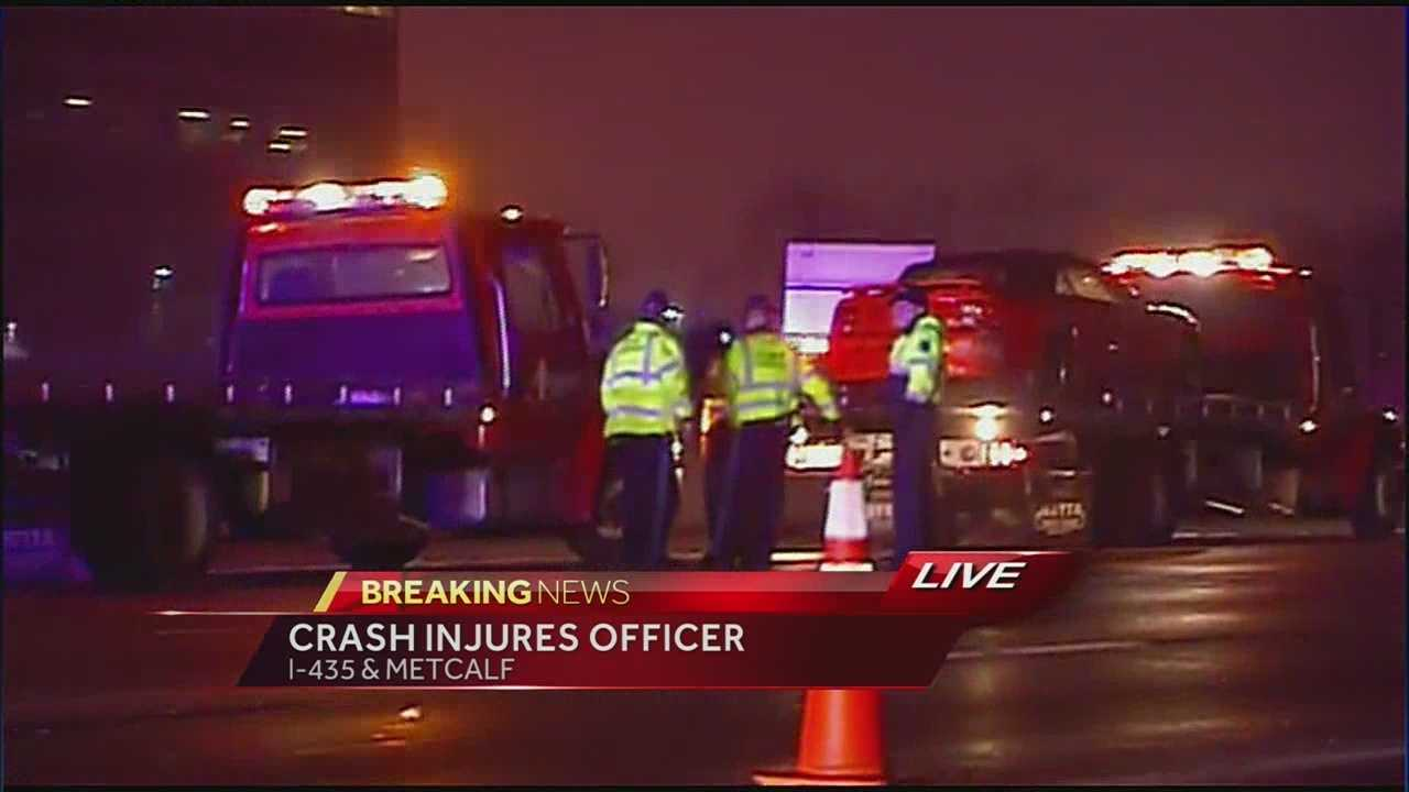 Officer injured in crash at I-435 and Metcalf
