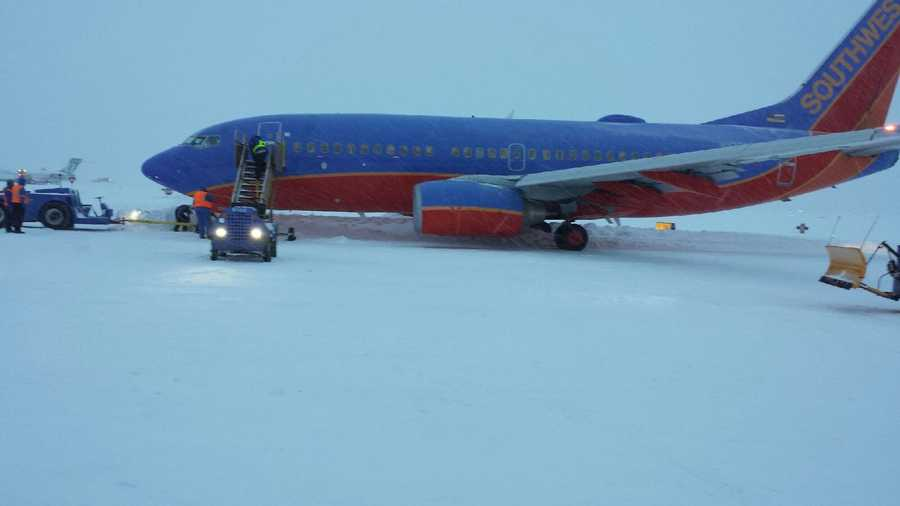 Images of a Southwest Airlines plane that got stuck in the snow at Kansas City International Airport on Tuesday afternoon.  The plane got stuck while taxiing, so passengers were taken off the plane and taken by bus to the terminal.
