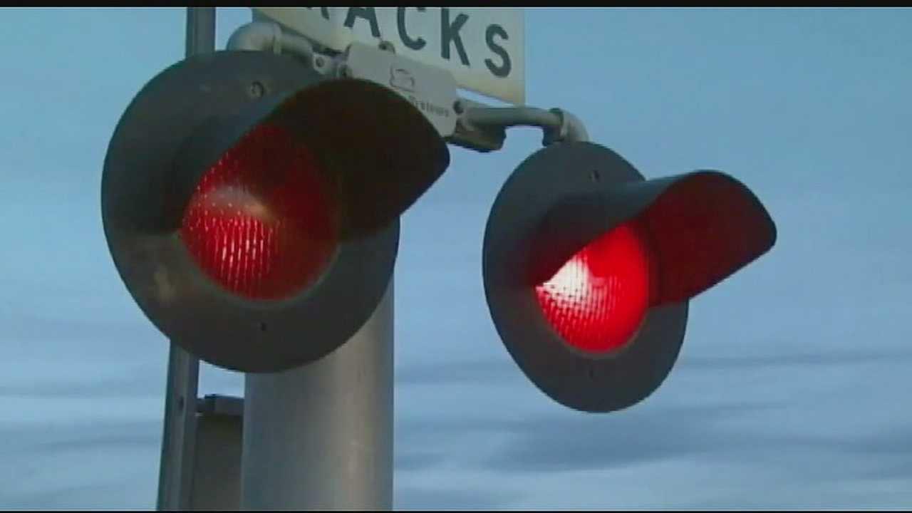 Image Generic railroad crossing lights, train