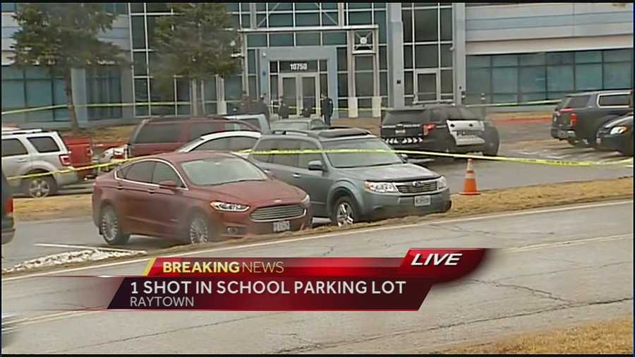 Images from a shooting in a parking lot at the Raytown School District Education Conference Center on Thursday morning. One person was dead, another person is in custody, according to police. They are calling it a possible domestic incident.