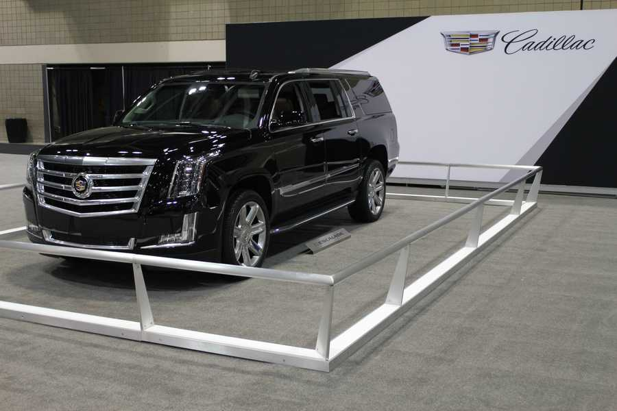 A sleek black Cadillac Escalade hangs out in this corner.  The KC Auto Show continues at the convention center until Sunday, March 9.