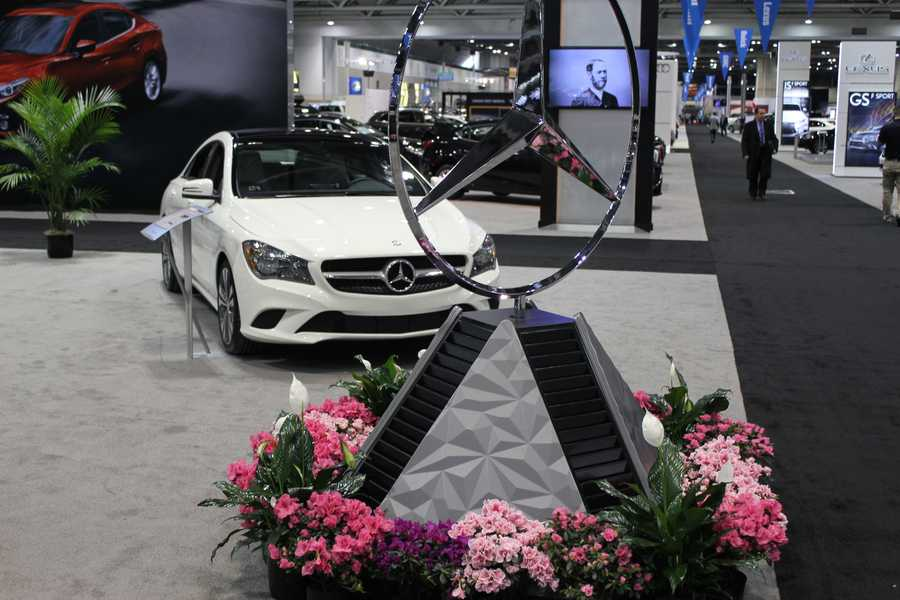 Mercedes-Benz recognizable brand spirals at the car show.