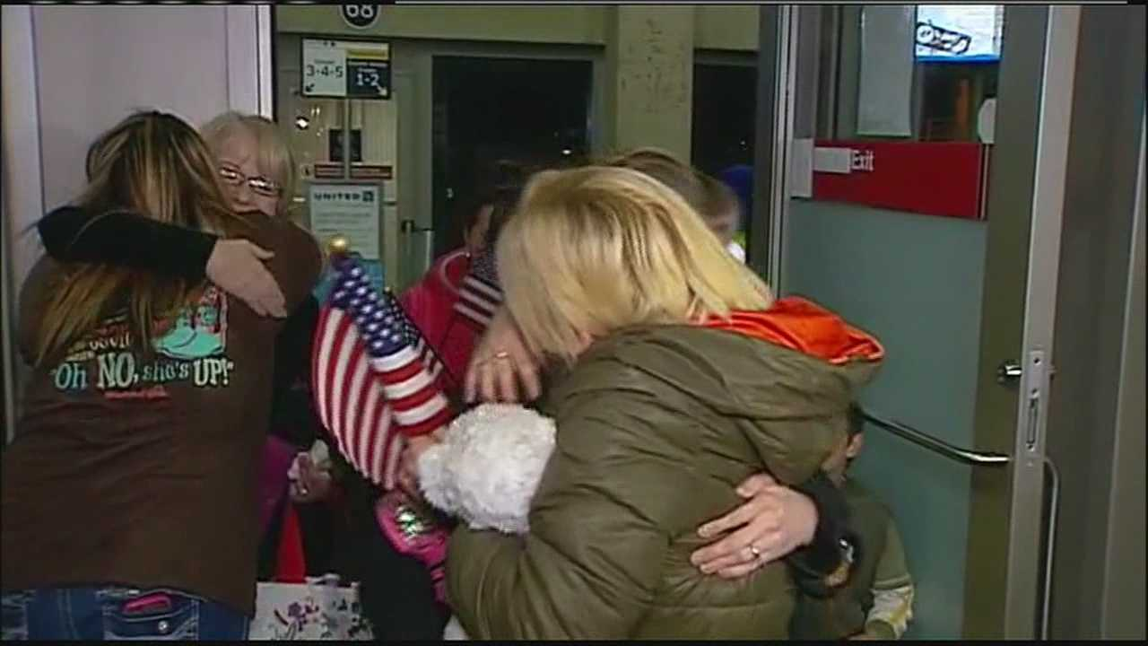 A Kansas couple and their four newly adopted children have made it home after a grueling trip to Ukraine, where civil unrest delayed their return for weeks.