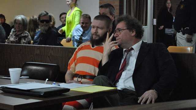 Kyle T. Flack, 28, Ottawa, who is charged in connection with the killing of three adults and an 18-month-old girl in spring 2013, talks with his court-appointed lawyer, Ronald Evans, head of the Kansas Death Penalty Defense Unit in Topeka, in Franklin County District Court, Ottawa.