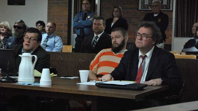 Kyle T. Flack, 28, Ottawa, who is charged in connection with the killing of three adults and an 18-month-old girl in spring 2013, sits with his court-appointed lawyer, Ronald Evans, head of the Kansas Death Penalty Defense Unit in Topeka, in Franklin County District Court, Ottawa.