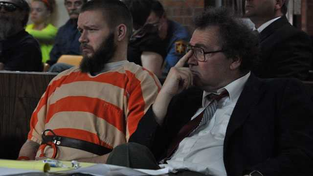 Kyle T. Flack, 28, Ottawa, who is charged in connection with the killing of three adults and an 18-month-old girl in spring 2013, sits Monday afternoon with his court-appointed lawyer, Ronald Evans, head of the Kansas Death Penalty Defense Unit in Topeka, in Franklin County District Court, Ottawa.