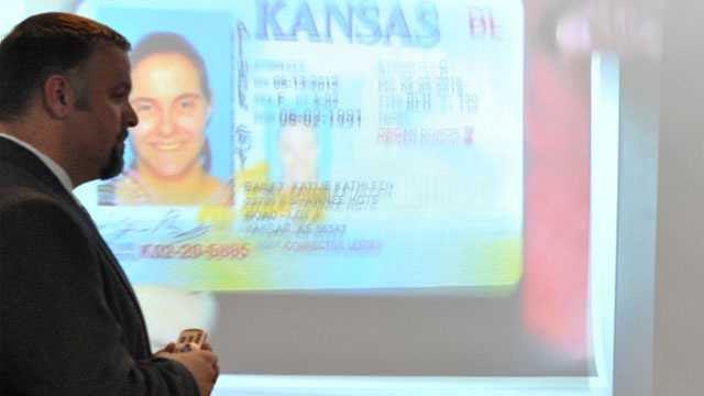 Ryan Rezzelle, crime scene supervisor for the Johnson County Sheriff's Office crime lab, presents a photo of Kailey Bailey's driver's license, which was recovered along with two bodies in a residence at 3197 Georgia Road, Tuesday afternoon during the preliminary hearing of Kyle T. Flack. The Johnson County Sheriff's Office was in charge of processing the crime scene at the Georgia Road residence where three of the bodies in the quadruple homicide were found.