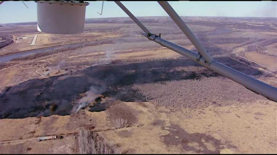 A large wildfire burned northwest of Kansas City International Airport on Thursday afternoon.  It appeared no homes were in danger.