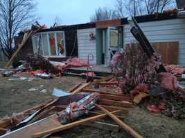 The storm shredded Larry Bailey's home. Bailey and his wife escaped unharmed.