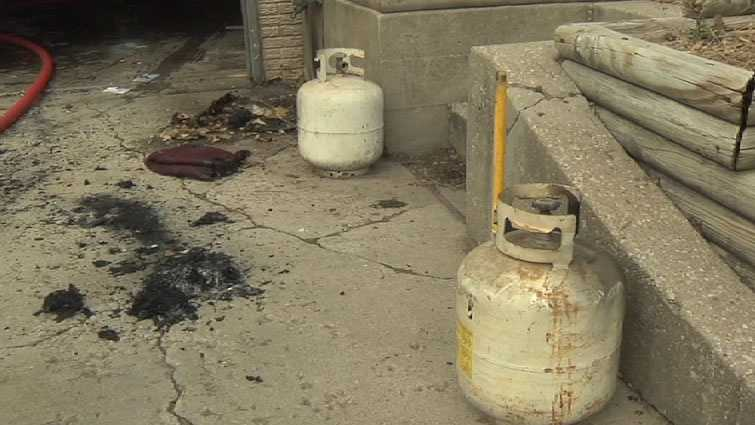 Investigators said the homeowner and set some old propane tanks in the driveway and opened the nozzles so they could empty. They said propane came into the garage and ignited from the furnace or water heater.